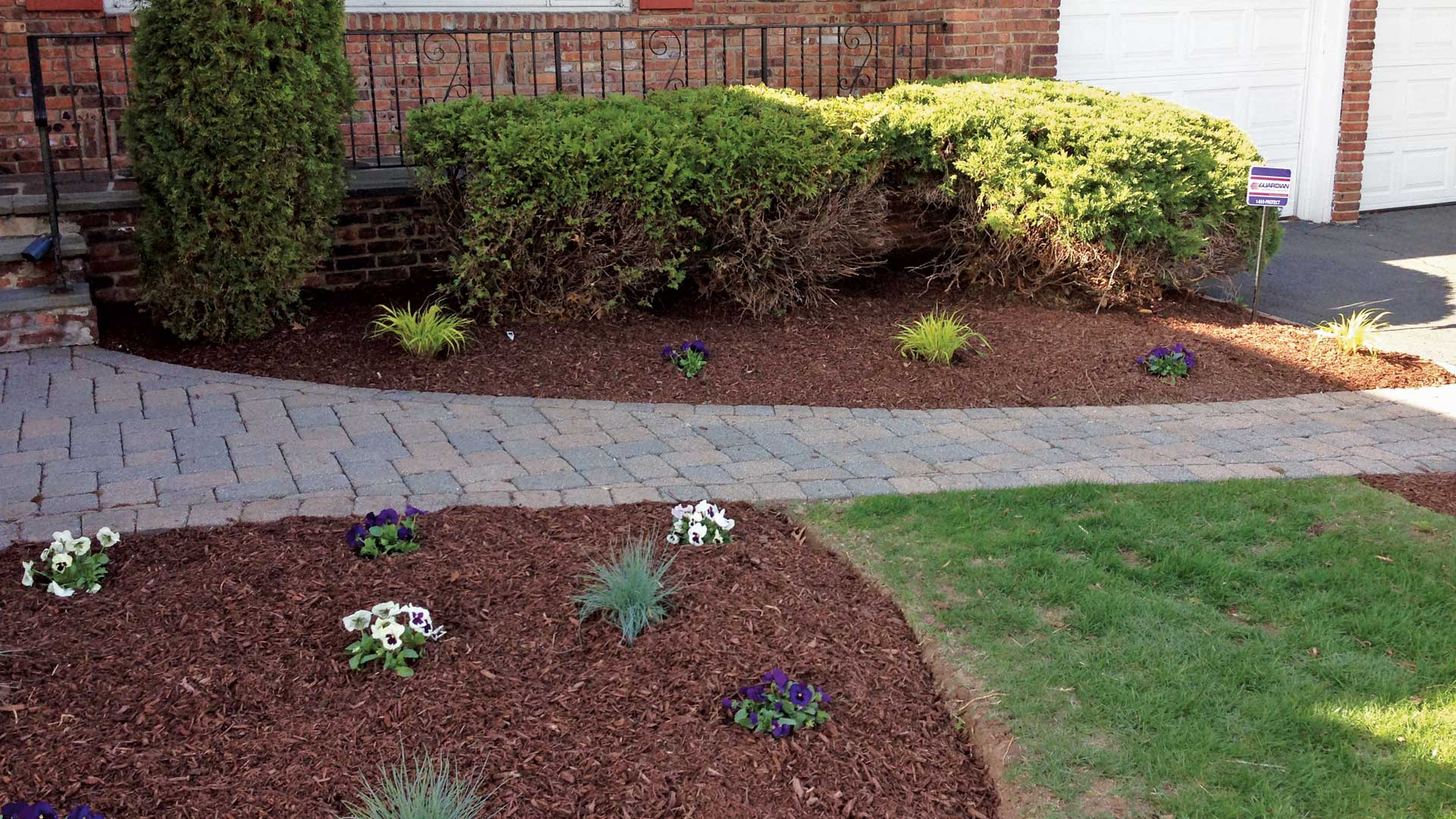 Fresh mulch and new annuals installed at a home in Cranford.